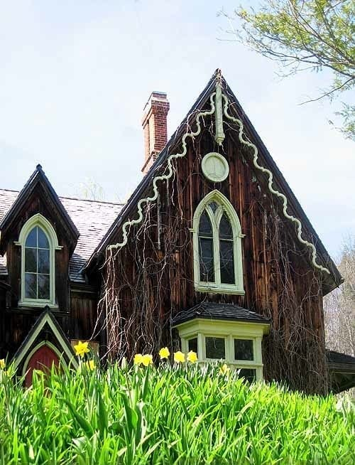 Gothic revival with it's strikingly steep gables and ornate