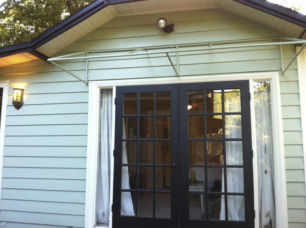 Transforming an old garage into a tiny house part 3 for Black french doors exterior
