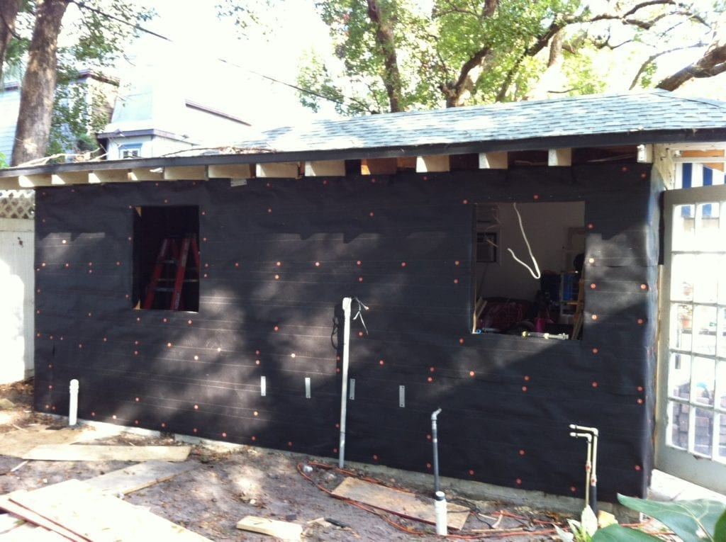 Transforming an old garage into a tiny house part 2 for Sheathing house wrap