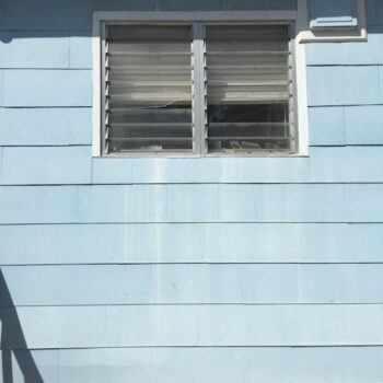 how to deal with asbestos siding